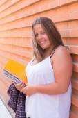 Large Student holds notebooks — Stock Photo