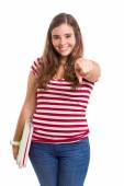 Young student girl pointing towards camera — Stock Photo