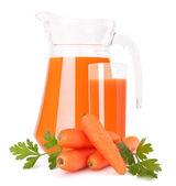 Carrot vegetable juice in glass jug — Stock Photo