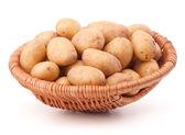 Potato tubers  in wicker basket — Stock Photo