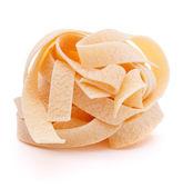 Italské těstoviny fettuccine hnízdo — Stock fotografie