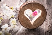 Light  heart on rustic wooden background — Stockfoto