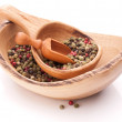 Pepper peppercorn mix in wooden spoon — Stock Photo #62654995
