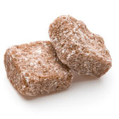 Brown lump cane sugar cubes — Stock Photo