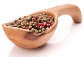Pepper peppercorn mix in wooden spoon — Stok fotoğraf