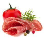 Salami sausage slice with tomato — Stock Photo