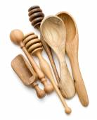 Carving wooden spoons and honey drippers — Stock Photo