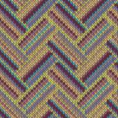 Seamless knitted pattern. Multicolored repeating tribal template — Vetor de Stock