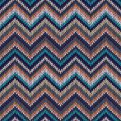 Seamless geometric ethnic spokes knitted pattern. Blue white ora — Stock Vector