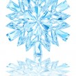 Light blue crystal snowflake on glossy white background — Foto Stock #65333069