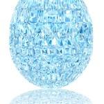 Light blue crystal easter egg on glossy white — Stock Photo #67777301