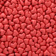 Background composed of many small red hearts — Stock Photo #67924935