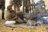 Soldiers resting near the fire — Stock Photo