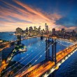 New York City - beautiful sunset over manhattan with manhattan and brooklyn bridge — Stock Photo #55681977