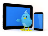 Little bird with smartphone and tablet — Stock Photo