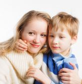 Mother and her little child sitting embraced — Stock Photo