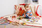 Cute boy playing with toy — Stock Photo