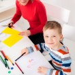 A little boy finished drawing a picture — Stock Photo #77586174