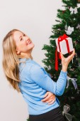 Laughing woman with gift — Stock Photo