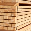 Stack of new wooden studs — Stock Photo #70385675
