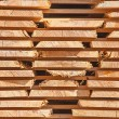 Stack of new wooden studs — Stock Photo #70385719