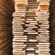 Stack of new wooden studs — Stock Photo #70386285