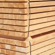 Stack of new wooden studs — Stock Photo #70386343