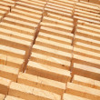 Stack of new wooden studs — Stock Photo #73000943