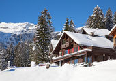 House in winter swiss alps — Stock Photo