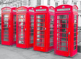 Red telephone booths in London — Stock Photo