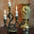 Antique candelabra with three melting candles on an old wallpape — Foto Stock #73525675