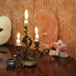 Antique candelabra with three melting candles on an old wallpape — Foto Stock #73525687