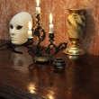 Antique candelabra with three melting candles on an old wallpape — Foto Stock #73525689