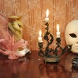 Antique candelabra with three melting candles on an old wallpape — Stock Photo #73525693