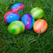 Close-Up of Six Colorful Easter Eggs in Grass — Stock Photo