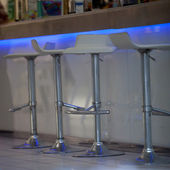 Close-Up of Bar Stools at Illuminated Bar — Stock Photo