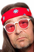 Man Wearing Headband and Rose Colored Glasses — Stock Photo