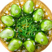 Green Glass Eggs in Basket — Stock Photo