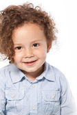 Portrait of Smiling Child with Curly Hair — Stock Photo