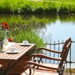 Vintage Wooden Table and Chair on Water Side — Stock Photo #55139099