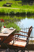 Vintage Wooden Table and Chair on Water Side — Stock Photo