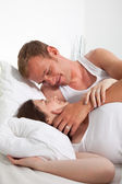 Romantic Middle Age Lying Lovers on Bed — Stock Photo
