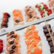 Variety of Canapes on Appetizer Trays — Stock Photo #58764045