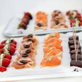Variety of Canapes on Appetizer Trays — Stock Photo