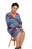 Chubby Adult Woman Sitting on Small Wooden Chair — Stock Photo