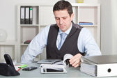 Handsome Businessman Calculating at his Worktable — Stock Photo
