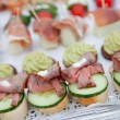 Variety of Appetizers Arranged on Platters — Stock Photo #65034829