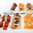 Variety of Appetizers Arranged on Platters — Stock Photo #65034867