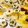 Variety of Appetizers on Cheese Platter — Stock Photo #65036649