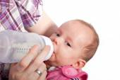 Feeding a Cute Baby with a Bottle of Milk — Stock Photo